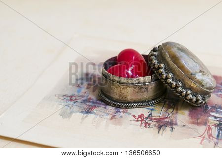 Retro decorative box with a red heart on an old greeting card