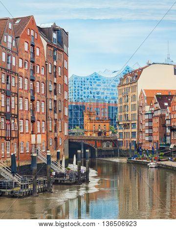 Picturesque view of Altstadt of Hamburg, Deichstrasse with philharmonie on background