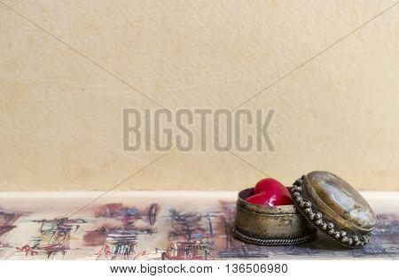 Small retro decorative box with a heart