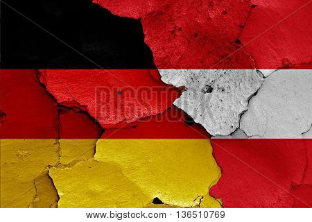 Flags Of Germany And Austria Painted On Cracked Wall