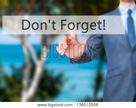 Don't Forget! - Businessman Hand Pressing Button On Touch Screen Interface.