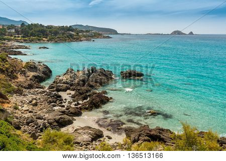 Translucent Sea And Rocky Coastline Of Corsica Near Ile Rousse