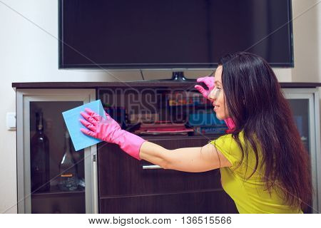 Maid woman with sponge. House cleaning service concept.