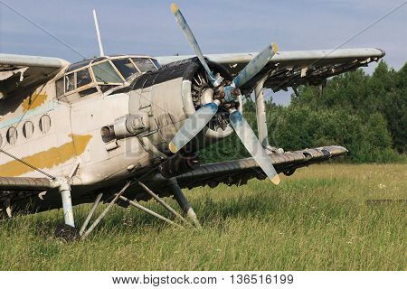 old aircraft standing on the green field