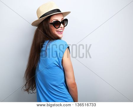 Happy Casual Toothy Laughing Woman In Summer Hat And Sunglasses On Blue Background