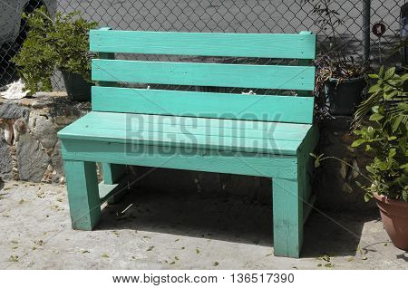 A turquoise bench sitting on a walk on St.John island.
