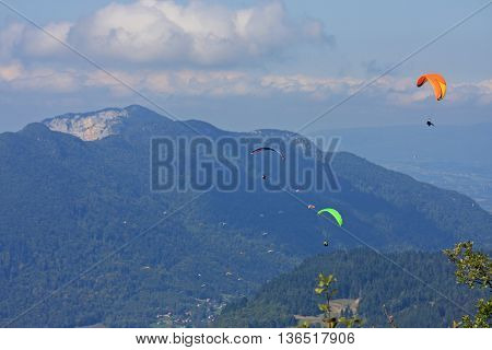 Paragliders flying in the mountains of the French Alps