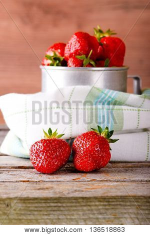Red Fresh Strawberries On Cloth In Front Of Aluminum Cup
