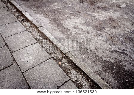 Old concrete tiles and old asphalt in the walkway. Abstract architecture background
