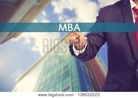 Businessman Hand Touching Mba (or Master Of Business Administration) Sign On Virtual Screen Vintage