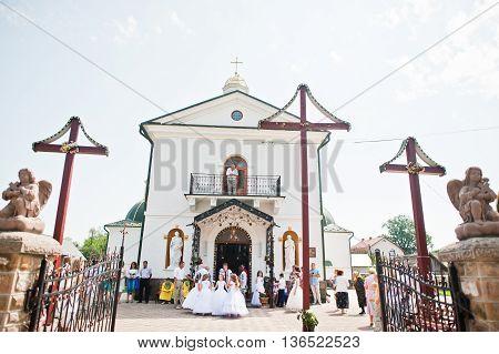 Mukyluntsi , Ukraine - 26 June, 2016: First Holy Communion. Children Stay Near Christian Church.
