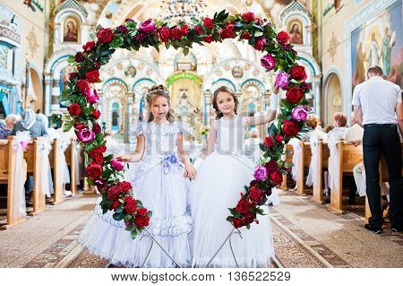 Mukyluntsi , Ukraine - 26 June, 2016: First Holy Communion. Two Baby Girl Stay At Heart Of Jesus Flo
