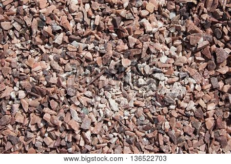Abstract background of stones of various fractions of brown color