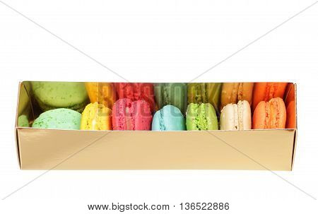 Colorful macaroons the golden box isolated on white background