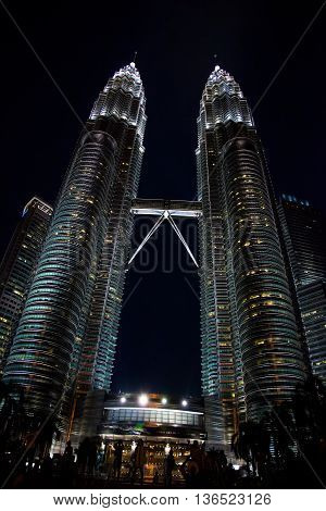 KUALA LUMPUR, MALAYSIA - January 23 : The Petronas Towers, also known as the Petronas Twin Towers, KLCC are twin skyscrapers in the feast of the monk Ammonium on January 23, 2014.
