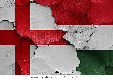 Flags Of England And Hungary Painted On Cracked Wall