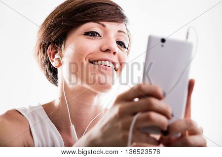 Woman Listening To Music On Her Mobile Phone