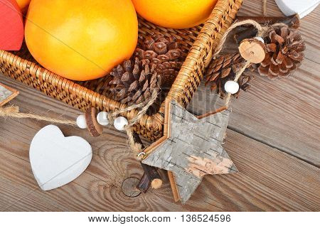 Orange In Wickered Tray With Christmas Decor