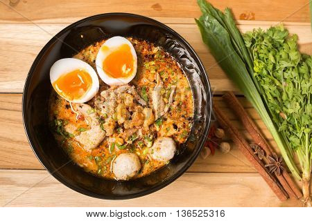 Thai noodle soup in a bowl taste spicy noodle soup and boiled egg
