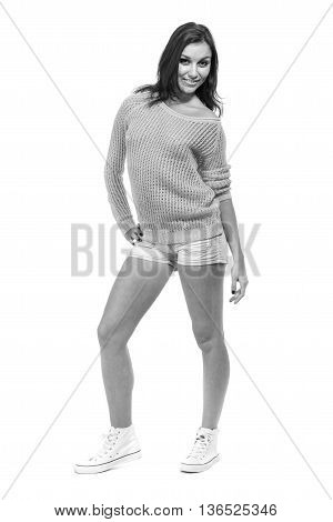 colorless portrait of pretty girl in shorts jeans standing full length in white background with copyspace