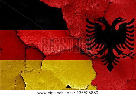 Flags Of Germany And Albania Painted On Cracked Wall