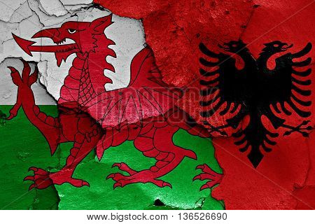 Flags Of Wales And Albania Painted On Cracked Wall