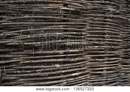 stale old wicker fence made of willow twigs