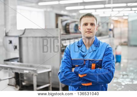 Portrait of a male Laundry worker at the dry cleaners