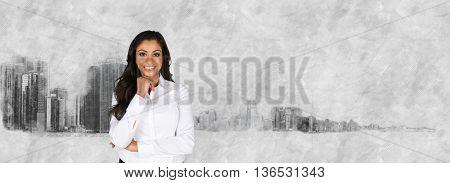 Female businesswoman standing outside against the skyline