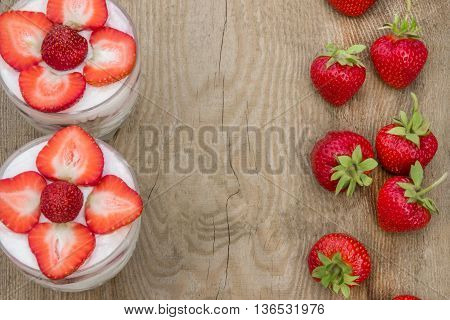 Dessert with cream and fresh strawberries (can be used as background, card)