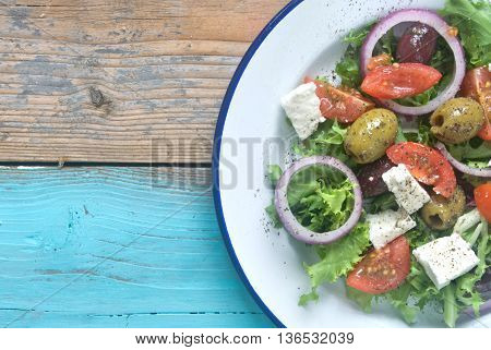 Plate of freshly made salad with tomatoes and feta