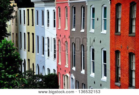 Baltimore Maryland - July 24 2013: Colorful early 19th century homes line Montgomerey Street in the Federal Hill Historic District