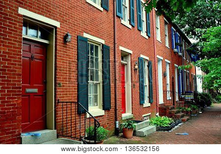 Baltimore Maryland - July 23 2013: Handsome late 18th and early 19th century homes line Montgomerey Street in the Federal Hill Historic District