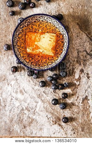 Honey Comb And Blueberries On A Stone Background Top View