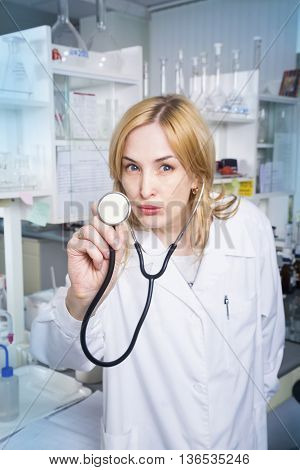 Expressive woman medical student in laboratory. Laboratory concept.