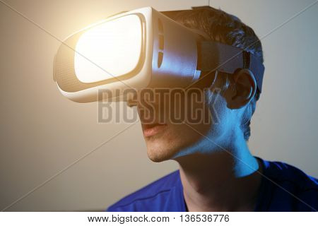Man wearing virtual reality goggles. Vr glasses concept.