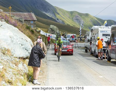 Col de la Croix de Fer France - 25 July 2015:The Lituanian cyclist Ramunas Navardauskas of Cannondale-Garmin Team leading the race riding to the Col de la Croix de Fer in Alps during the stage 20 of Le Tour de France 2015.