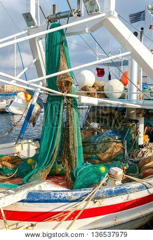 Fishing nets on the ship near the pier.