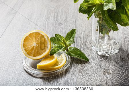 The Cut Lemon On A Glass Stand