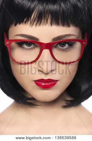 Close- up of a young beautiful woman with red glasses.