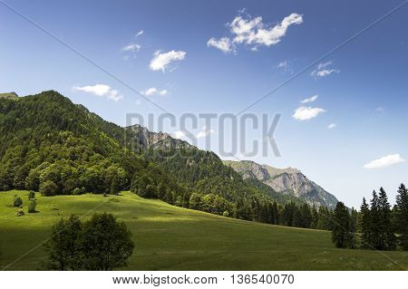 Perfect day in the mountains. Landscape in Romania with view towards Caraiman heroes cross monument
