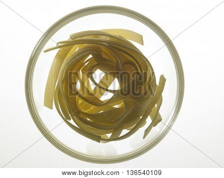 raw fettuccine on the white background