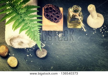 Spa setting with beauty treatment accessories - essential oil herbal ball and soap bar. Wellness concept top view