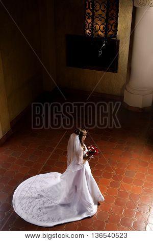 A beautiful bride awaits her groom before the wedding.