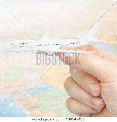 Traveling, Tourism, Communications And All Things Related - Studio Shot Of Toy Aircarft In Hand With