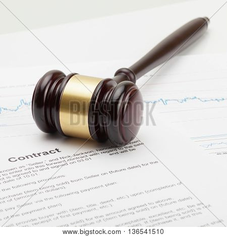 Wooden Judge's Gavel Being Put Over Contract - Close Up Studio Shot