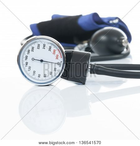 Close Up Studio Shot Of A Blood Pressure Measuring Medical Equipment On White Background - A Tonomet