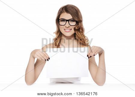 Beautiful young woman with black glasses holding blank white sign