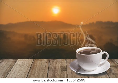 Cup Of Coffee With Mountain At Morning Sunrise.