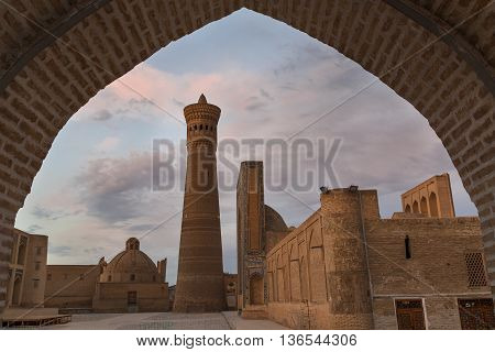 Poi Kalon Mosque and minaret through the arch.